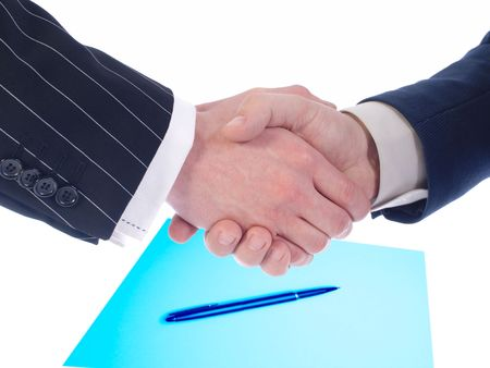 Friendly hand shake business of partners on  background of documents photo