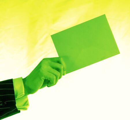 mailmen: Mans hand with single envelope on light background