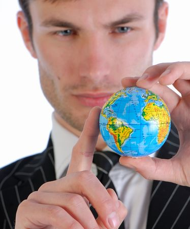 dataflow: young businessman in  business suit holds model of globe in  hand and reflects Stock Photo
