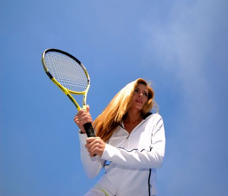 actively: Portrait of  woman in  age of 40-45 years actively engaged in tennis