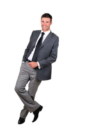 Smiling  businessman standing full length isolated on white background  Stock Photo - 5518174