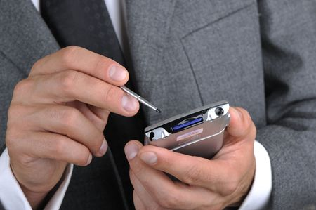 businessman works as a portable computer, hands a closeup Stock Photo - 5701558
