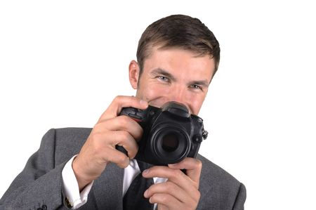 Portrait of the young nice photographer isolated on a white background photo