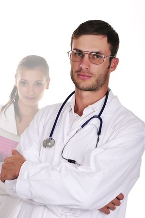 The serious young doctor in glasses and the young nurse isolated on a white background Stock Photo - 6109330