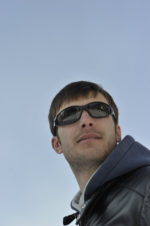 cool dude: Portrait of the young nice guy in black glasses, midday, day