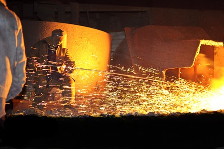 metallurgy: steelmaker burns oxygen opening for producing of cast-iron from a high furnace