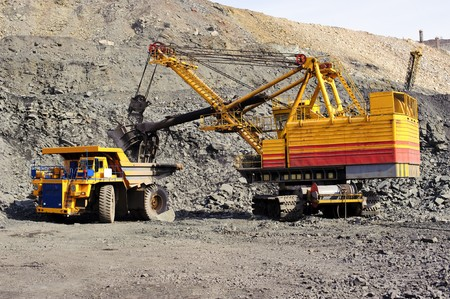 Loading and export of iron ore in career by open way by means of dredges and lorries photo