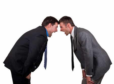 Two young businessmen aggressively shout each other, isolated on a white background