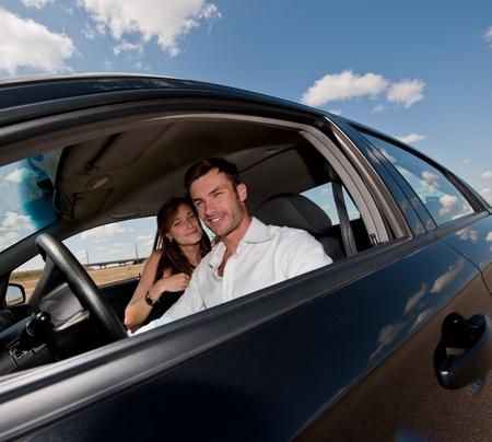 旅には、車のホイールで若い素敵なビジネスマンが晴れた日 写真素材
