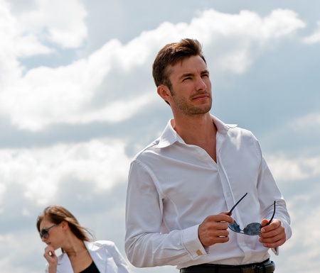 Quarrel, the conflict of young men against clouds, a sunny day Stock Photo - 8667787