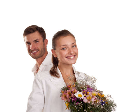 Portrait of a young pair with a bunch of flowers isolated on a white background photo