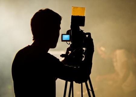 video operator behind work photo