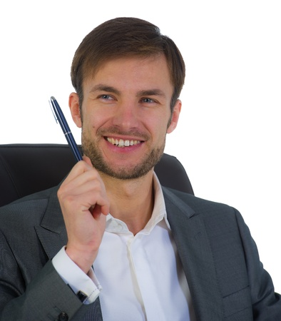 businessman at office sits in a chair looks aside and has control over a notebook Stock Photo - 18523868