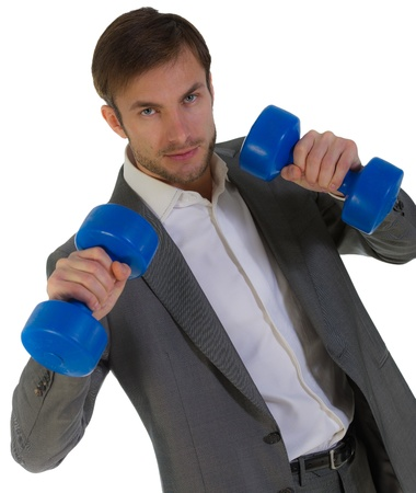 resolute: resolute serious businessman with dumbbells in the hands, isolated on a white background