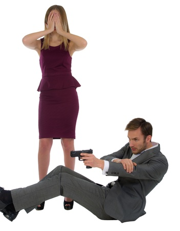 security guard shoots from the gun protects the woman isolated on a white background photo