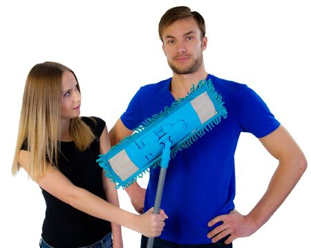 young woman offers the man a mop for cleaning in �����, isolated on a white background photo