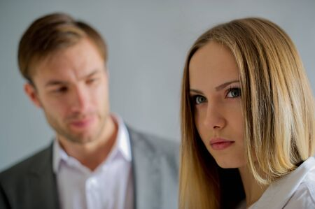 sad conversation of partners in business of the man and the woman at office photo
