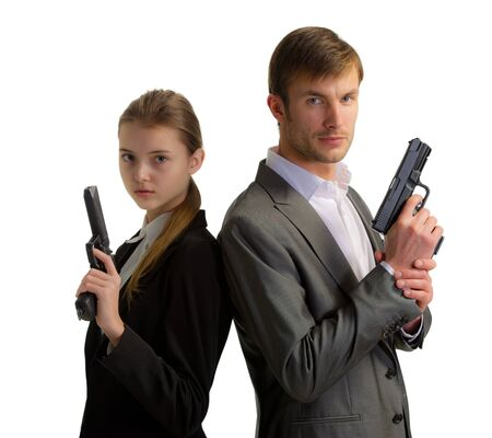 hand guards: couple of nice bodyguards the man and the woman with guns in hands isolated on a white background Stock Photo