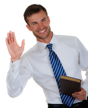 businessman welcomes hand gesture with a notebook in a hand, isolated on a white background Stock Photo - 18913194