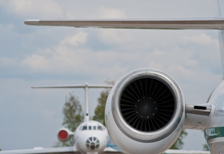 aluminum airplane: turbine of the passenger small plane at the airport in a sunny day Stock Photo