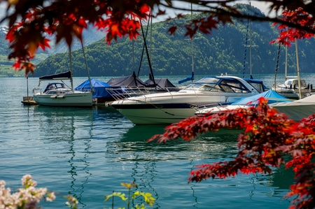 yachts at the mooring, the lake Lucerne, Switzerland, against mountains photo