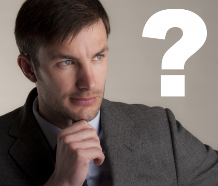 serious businessman thought of a question photo