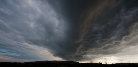 thundercloud: thundercloud over an industrial zone in the steppe