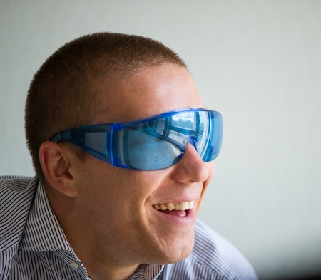 the nice smiling guy wearing spectacles photo