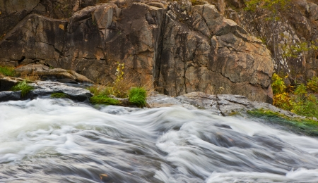 fast-flowing water of the river and granite rocks, fall photo