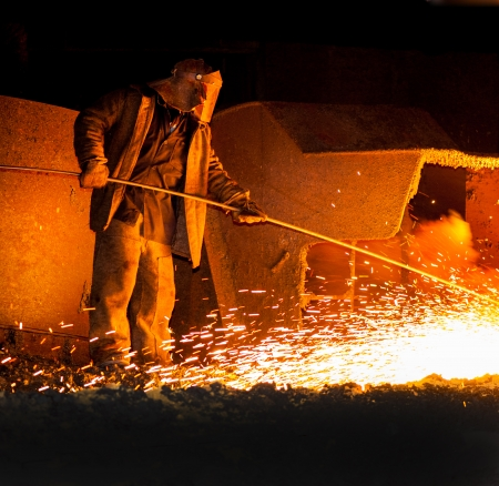metallurgist: professional metallurgist controls before the release of iron smelting Stock Photo
