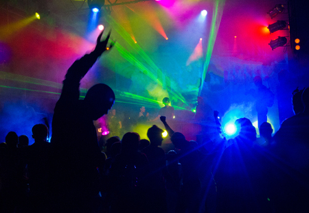indigent: A crowd of people relaxing and having fun in a disco Stock Photo