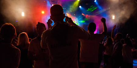 A crowd of people relaxing and having fun in a disco photo