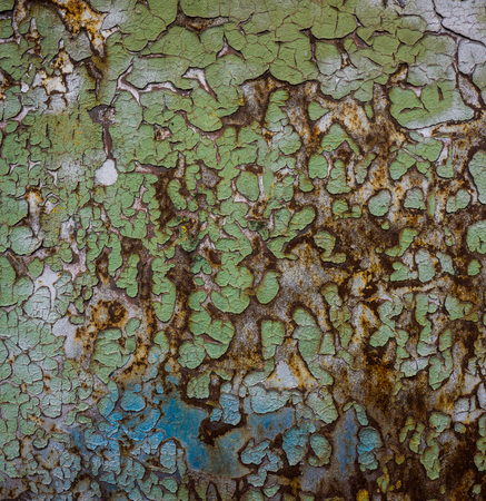old sheet metal covered with rust and damaged paint photo