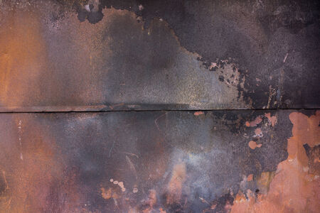 soot: charred metal sheet covered with paint  rust and soot