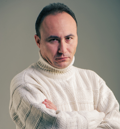 disbelief: Portrait of a businessman in a sweater looking at the camera in disbelief, age thirty-five, thirty-seven years Stock Photo
