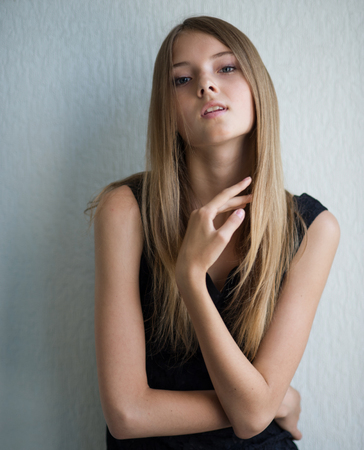 loose hair: portrait of a beautiful young woman who corrects loose hair  Stock Photo