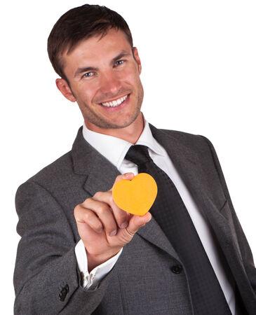 businessman with an orange heart in hand on Valentine photo
