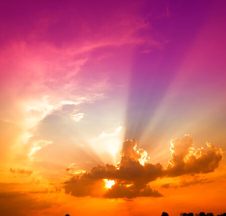 spring evening, beautiful sky with rays and clouds at sunset photo