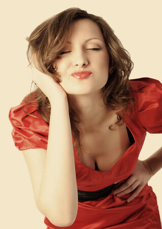 coquettish: Female portrait  Coquettish beautiful young woman doing a kiss