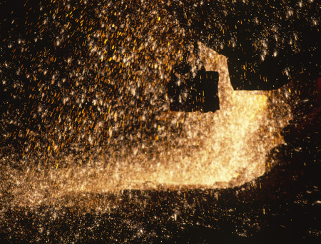 Metallurgic production, production of cast iron, metal melting  Fire sparks and molten metal splashes  photo