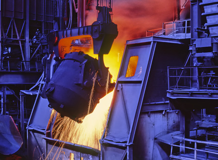 Pouring molten metal  Metallurgical industry  Pouring liquid metal into an open hole