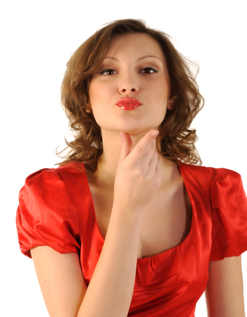 The girl sends an air kiss  Portrait of beautiful girl isolated on white background  photo