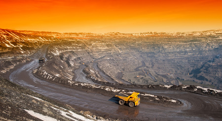 Dump trucks and roads to deliver ore and auxiliary cargo career on extraction of iron ore  photo