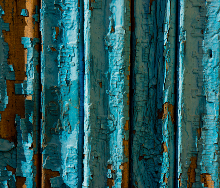wooden wall and surface covered with old paint cracked blue photo