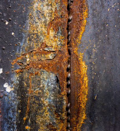 surface of a metal sheet coated with old peeling paint, the destruction of the weld photo
