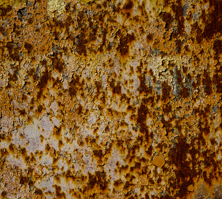 old rusty metal sheet covered with old paint residues photo