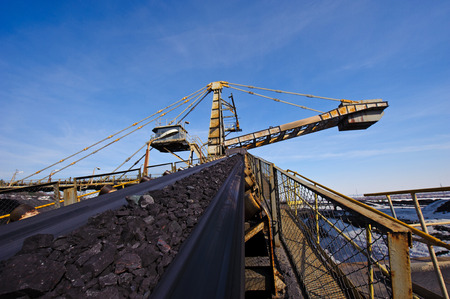 coal mine: loading iron ore conveyor machine from the warehouse, mining production