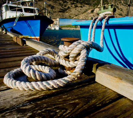 old boat in the bay at the pier on the sea background  photo