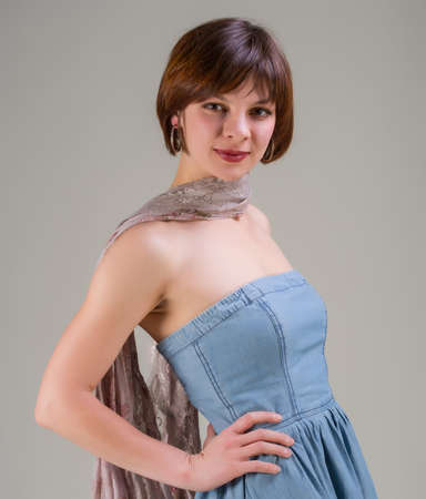 portrait of a pretty young woman in jeans dress and scarf photo