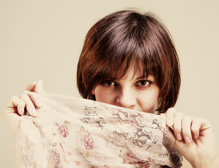 portrait of a pretty young woman with short hair on a light background, age 30 years photo